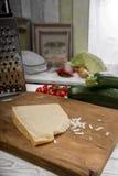 Parmesan on chopping board Stock Image