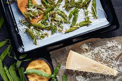 Parmesan and cornmeal breaded Snap Peas, close-up royalty free stock photo