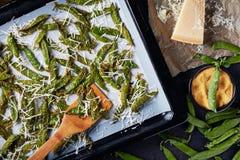 Parmesan and cornmeal breaded Snap Peas, close-up stock photos