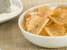 Parmesan Crisps. A Dish of Parmesan Crisps stock images