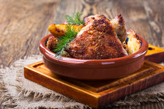 Parmesan crusted chicken thighs. Homemade oven fried parmesan crusted chicken thighs Stock Photos