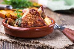 Parmesan crusted chicken thighs Stock Photo