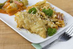 Parmesan crusted fish dinner detail Royalty Free Stock Photography