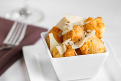 Parmesan gougeres. Fried cheese puffs with cracked black pepper Stock Photo