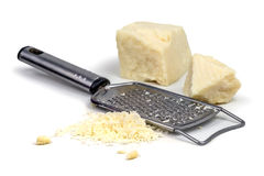 Parmesan. With grater on wood table royalty free stock image
