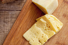 Parmesan and sliced dutch cheese Stock Photos