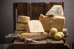 Free Parmesan, Taleggio, Caciotta And Asolo Cheese On Dark Wooden Table Royalty Free Stock Image - 127630206