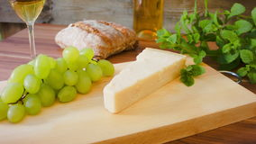 Parmesan with white wine. grapes and bread stock video footage