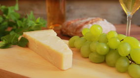 Parmesan with white wine. grapes and bread stock footage
