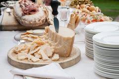 Parmesano en la comida fría Imagen de archivo