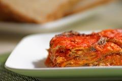 Parmigiana di Melanzane. Aubergines parmigiana, typical italian vegan dish Royalty Free Stock Photo