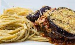 Parmigiana di melanzane. Homemade Parmigiana di melanzane with Pasta Royalty Free Stock Photo