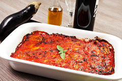 Parmigiana eggplant on a wood table Royalty Free Stock Photos