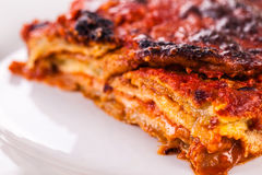 Parmigiana in a plate detail. A delicious plate of italian parmigiana made with eggplant Royalty Free Stock Photo