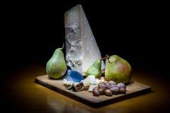 Parmigiano italiano e frutti Fotografia Stock