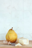 Parmigiano and pear, with knife Stock Photo