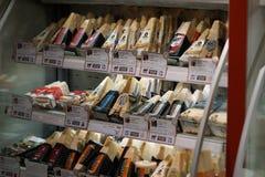 Parmigiano Reggiano cheese. Rome, Italy - December 22, 2017: Parmigiano Reggiano cheese in Eataly shop. Parmigiano-Reggiano, or Parmesan cheese, is a hard Stock Images