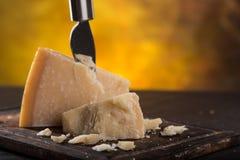 Parmigiano reggiano on wooden background Royalty Free Stock Photo