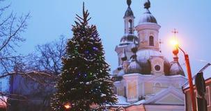 Parnu, Estonia. Christmas Tree In Holiday New Year Festive Illumination And St. Katherine Orthodox Church On Background stock video