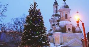Parnu, Estonia. Christmas Tree In Holiday New Year Festive Illumination And St. Katherine Orthodox Church On Background stock footage