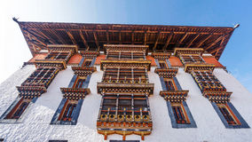 PARO BHUTAN MARCH 02 2016 :the main tower for prayer with asian. Art window and roof at Paro Dzong, Bhutan Royalty Free Stock Photography