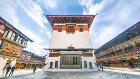 PARO BHUTAN MARCH 02 2016 :people around the plaza. PARO BHUTAN MARCH 02 2016 :people around the plaza with the white heritage art main tower at Paro Dzong Royalty Free Stock Image