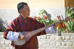 PARO, BHUTAN - November10, 2012 : Unidentified old man musician Royalty Free Stock Photos