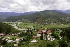 Paro, Bhutan, view of Paro Dzong. Panoramic view of Paro Dzong, Paro Valley, and Paro rivier during raining, Bhutan Stock Photo