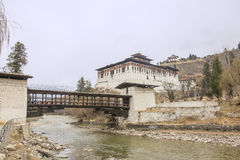 Paro Dzong, bridge and watch tower. The traditional stile bridge, Paro dzong and watchtower. The Paro Dzong, like all dzongs is partly a government building and Royalty Free Stock Image