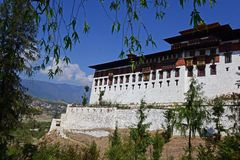Paro Dzonge Of Bhutan. Paro Dzong is one of the first Dzongs that visitors see on arrival by plane into Bhutan. It is also known as the Rinpung Dzong which means Royalty Free Stock Images