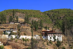 Paro Rinpung Dzong. Buddhist monastery and fortress, on a hill above a river Paro Chu near to the city Paro Stock Photos