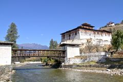 Paro Rinpung Dzong, The traditional Bhutan palace with wooden br. Idge across the river  Paro Chu near to the city Paro, BHUTAN Royalty Free Stock Photo