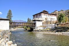 Paro Rinpung Dzong, The traditional Bhutan palace with wooden br. Idge across the river  Paro Chu near to the city Paro, BHUTAN Stock Photo