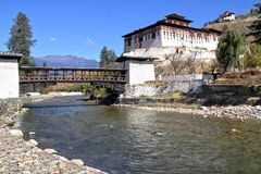 Paro Rinpung Dzong, The traditional Bhutan palace with wooden br. Idge across the river  Paro Chu near to the city Paro, BHUTAN Royalty Free Stock Photography