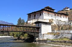 Paro Rinpung Dzong, The traditional Bhutan palace with wooden br. Idge across the river  Paro Chu near to the city Paro, BHUTAN Stock Images