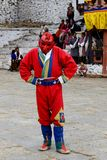 Paro Tsechu Festival. A monk with musk making fun as well as he is coordinate the festival programme Stock Photography