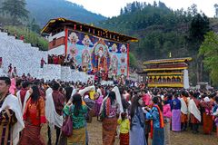 Paro Tsechu Festival. Visitors during the Paro Tsechu (religious festival) in The Kingdom of Bhutan in the land of the thunder dragon high in the Himalayas Stock Image