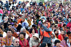Paro Tsechu Festival. Visitors during the Paro Tsechu (religious festival) in The Kingdom of Bhutan in the land of the thunder dragon high in the Himalayas Royalty Free Stock Images