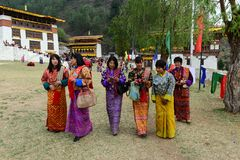 Paro Tsechu Festival. Visitors with traditional dress during the Paro Tsechu (religious festival) in The Kingdom of Bhutan in the land of the thunder dragon high Stock Photos