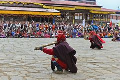 Paro Tsechu Festival. Young monks making music during the Paro Tsechu (religious festival) in The Kingdom of Bhutan in the land of the thunder dragon high in the Royalty Free Stock Photos