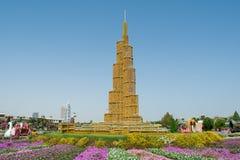 Parody on the Burj Khalifa tower at the flower field. Parody on the Burj Khalifa tower at the garden near flower field Stock Photos