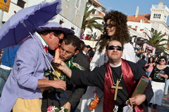 Parody about the controversial Gay Marriage during. Sesimbra, Portugal – February 12, 2013 – Satire to gay marriage with grooms, a catholic priest and Royalty Free Stock Photo