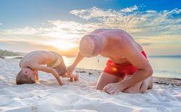 Parody of girls: sand on the bald head is like flying hair.  Royalty Free Stock Photos