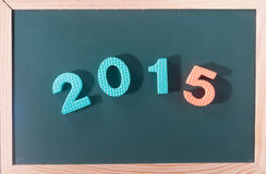 Parola Colourful 2015 al bordo nero come fondo Immagini Stock