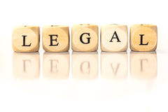 Parola compitata legale, lettere dei dadi con la riflessione Immagini Stock Libere da Diritti