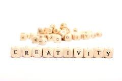 Parola con creatività dei dadi Fotografie Stock
