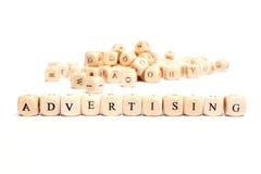 Parola con la pubblicità dei dadi Immagine Stock