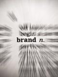 Parola del dizionario di marca con effetto di fuoco della sfuocatura dello zoom Fotografia Stock