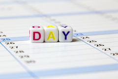 Parola del giorno presentato su un calendario Immagine Stock Libera da Diritti