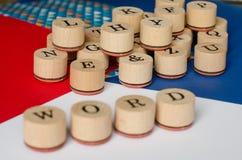 PAROLA del testo sui bolli di legno Fotografia Stock